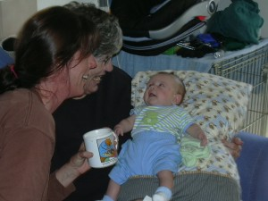Aunt Lauren and Grandma talking to Xander Bear.